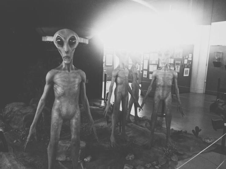 One of the cooler features of the International UFO Museum and Research Center: life-size (??) grey aliens, complete with periodic bursts of smoke from a life-size (??) saucer.